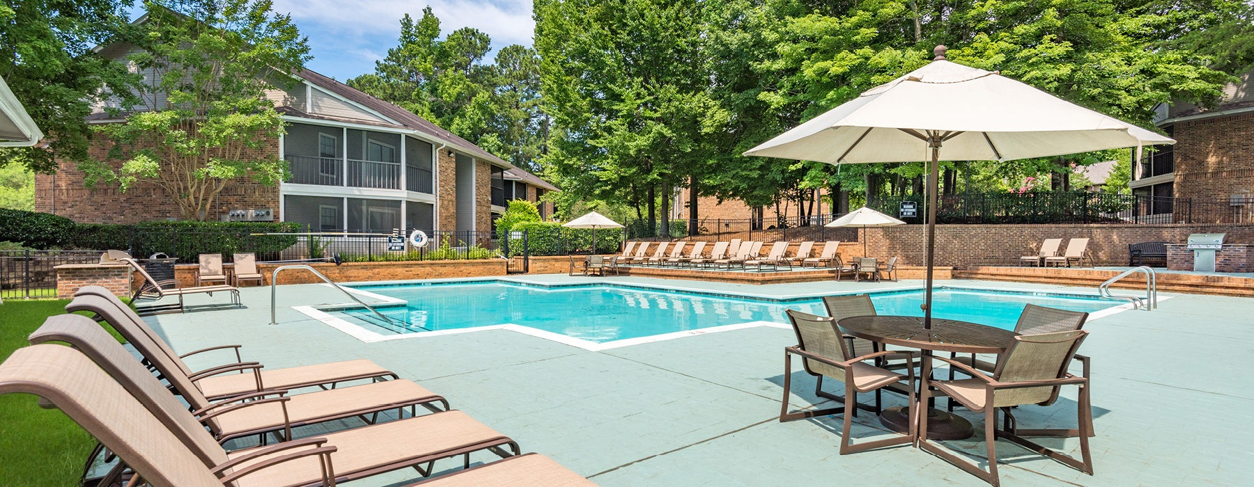 outdoor pool with sundeck and lounge chairs