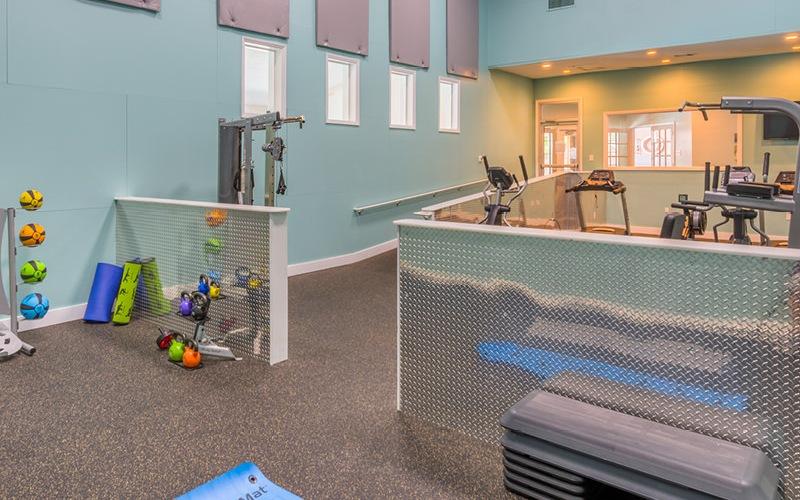 well lit, roomy fitness center