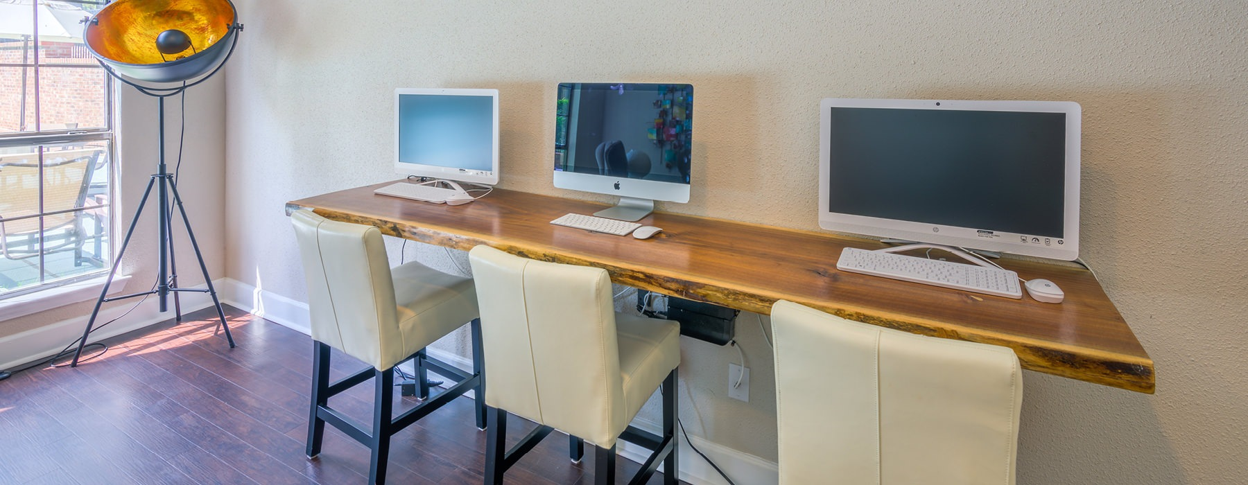 computer work stations against a wall in well lit room